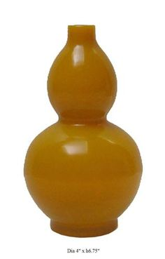 Peking glasses are made at a extremely high temperature (over 1000℃), that's why it has higher density and more beautiful color than regular glass.    This imperial yellow Peking glass gourd shape vase definitely will be an eye catching item in your room.