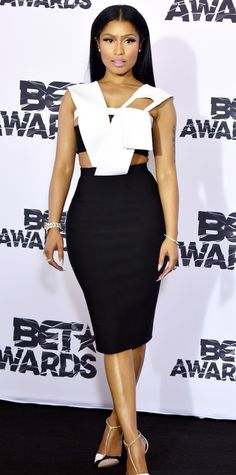 Nicki Minaj hit the 2015 BET Awards in a surprisingly tame outfit, eschewing her usual crazy prints in favor for a black-and-white sculptural number with cut-outs at the shoulders and waist. Silver jewelry and Rene Caovilla T-strap pumps completd her look.