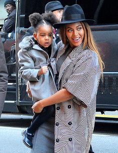 Beyonce holds Blue outside of the Ziegfeld Theatre in NYC for the Annie premiere.