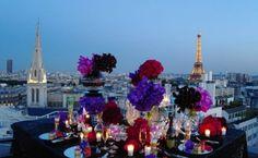Rooftop dinner set up at Four Seasons George V, Paris  Thousands of fresh flowers flown in daily from The Netherlands.