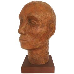 Terracotta Head Sculpture on a Wood Base Offered for sale is a terracotta sculpture of a man's head which is illegibly signed on the bottom. The sculpture is rustic in nature with a textured finish. The sculpture rests upon a wood plinth which measures by Decorative Objects, Terracotta, Sculptures, Rustic, Statue, Base, Wood, Vintage, Devil