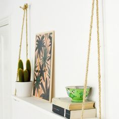 33 Gorgeous DIY Projects To Decorate Your Grown Up Apartment; Sisal rope to a painted board for a hanging shelf Diy Hacks, Organizing Hacks, Diy Home Decor On A Budget, Diy Home Decor Projects, Cheap Home Decor, Decor Ideas, Decorating Ideas, Diy Ideas, Home Decoration
