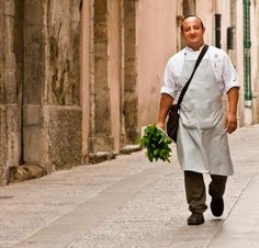 Chef Ciccio Sultano, seen here with his bunch of parsley, is perhaps Sicily's most famous chef - 2-MICHELIN-STAR. Il Duomo, Ragusa
