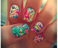 Paint Splatter Nails - First, paint your nails white. Then, get a straw ,dip it it paint, and blow on your nails. (make sure to have a towel underneath, this may be messy!)
