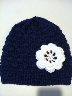 beanie with knit flower and embellishment in the middle.... love
