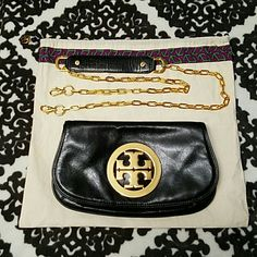Tory Burch Reva Gold Logo Crossbody This is in perfect condition. The leather doesn't have any scratch, rips, discoloration or signs of wear other than the leather is softer which is normal. The detachable gold crossbody hardware is literally scratch free and the Gold T logo has very tiny and unnoticeable scratches (shown in picture #2). Interior is in pristine condition.  WILLING TO TRADE, preferably to another TB clutch or Marc Jacobs clutch. Tory Burch Bags Crossbody Bags