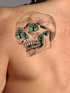 This cool skull tattoo seems to glow from within, and features a forest of barren trees. Skull tattoos can represent an acceptance of mortality. This temporary tattoo symbolizes a balance between exti