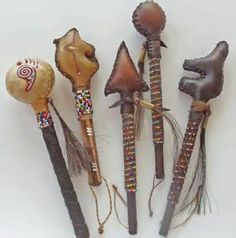 NATIVE AMERICAN RATTLES ( shaped & stitched rawhide)
