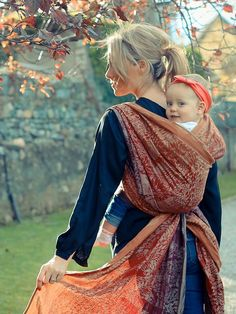 Autumn walk with a baby wrap.