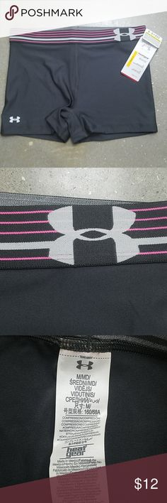 """NWT Under Armour Compression Running Shorts NWT Under Armour Compression Shorts Grey shorts. Pink and silver stripes on top.  Heat Gear Shorty 3"""" Under Armour logo on front right W 14.5"""" L 11"""" Under Armour Shorts"""