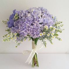 Bridesmaid Bouquet: another idea that is also very simple and sweet--we could do a white hydrangea accented with the white wax flower and wedding foliage around the outside. Lavender Bouquet, Hydrangea Bouquet, Floral Bouquets, Wedding Bouquets, Bridesmaid Bouquet, Daisy Wedding, Wedding Pins, Floral Wedding, Dream Wedding