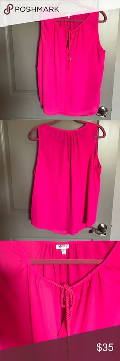Hot Pink Blouse Brand new, never worn hot pink Sleeveless Blouse with fringe tie details! Purchased from local boutique! Marisol Tops Blouses