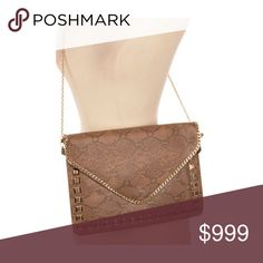 """Snakeskin multifunction envelope bag Envelope clutch/ wristlet/ crossbody. Measures 12"""" long and 9"""" tall. Crossbody strap has a 22"""" drop. Chain can be tucked inside. Inside has two pouches- one zip and one non zip. Side handle can be removed. Gold hardware. This has a faux leather look and feel.  ⭐️This item is brand new with tags 🚫NO TRADES 💲Price is firm unless bundled 💰Ask about bundle discounts Bags Crossbody Bags"""
