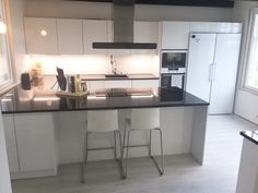 Puustelli kök / keittiö / kitchen by Thomas Berglund High glossy MDF with a black granite counter-top