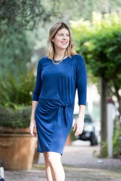 I love the ruching on this blue dress from Anthropologie! Abby Savvy