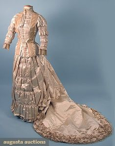 Augusta Auctions, April 2006 Vintage Clothing & Textile Auction, Lot 807: Trained Ivory Satin Wedding Gown, 1880s