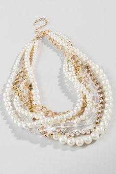 """Update your traditional pearl necklace with the Madison Strand Necklace. These pearls are accented with golden chains, clear crystals & shimmering rhinestones! Wear this with a black dress & heels for a classic look!<br />  <br />  - Finished with a lobster claw clasp<br />  - 19"""" length<br />  - 3"""" extension< - Lead & nickel free - Imported"""