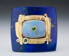 Lapis and opal brooch by Michael Boyd,,,I love the deconstructed look of this brooch, with the main stone capturing the metal, instead of the other way around,