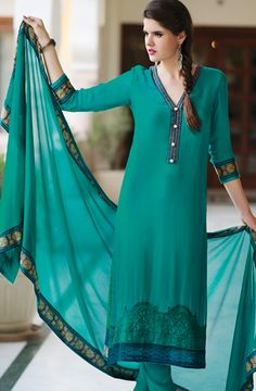 To complement your graceful demeanour, Tacfab brings to you this teal green salwar kameez dupatta set. Fashioned from georgette, this unstitched suit set is accented with detailed embroidery in the front along with exotic prints in the back. Team this gorgeous beauty with high heels for a stunning look.