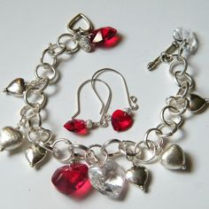 SOLD Many Hearts by Wildheather. This bracelet features a sterling silver heart…