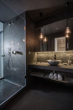 shower divide for the centre of the room. double sinks housed like this .. note:lighting  | Prague Modern Loft Apartment Bathroom