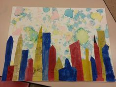 This is a project I did with one of my 5th grade classes for our annual art auction. It's colored bubbles for the background and newspaper with watercolor for the buildings!