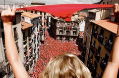 View from a (RunningoftheBulls.travel) terrace during the San Fermin Festival in Pamplona that occurs every July.