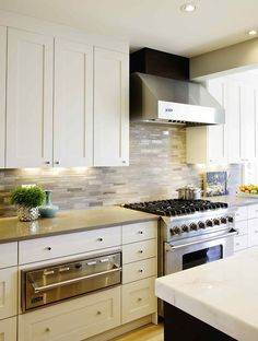 Luxury White Cabinets with Stone Backsplash