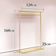 Vitrin Golden Metal Clothes Rack Display Fixture Organizer How To Choose Suitable Home Theater Seati Wall Mounted Clothing Rack, Wood Clothing Rack, Metal Clothes Rack, Kids Clothing Rack, Diy Clothes Rack, Clothes Drying Racks, Clothing Stores, Hanging Clothes Racks, Boutique Interior