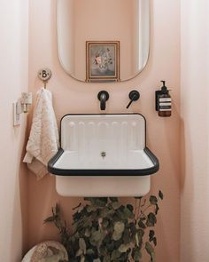 This townhome is a minimal, modern, monochromatic dream house with a pop of pink in its small bathroom. diy Dream house A Modern, Otherwise Monochrome Home Has a Precious Pink Guest Washroom Design Jobs, Home Design, Design Ideas, Design Trends, Bath Design, Design Design, Design Inspiration, Blush Bathroom, Bathroom Mirrors