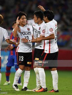 Toshiyuki Takagi of Urawa Red Diamonds#13 celebrates scoring his team's first goal during the J.League Levain semi final first leg match between FC Tokyo and Urawa Red Diamonds at Ajinomoto Stadium on October 5, 2016 in Chofu, Tokyo, Japan.