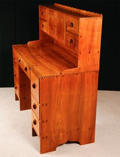 A Walnut Cotswold School Arts and Crafts Kneelhole desk. | From a unique collection of antique and modern desks at https://www.1stdibs.com/furniture/storage-case-pieces/desks/