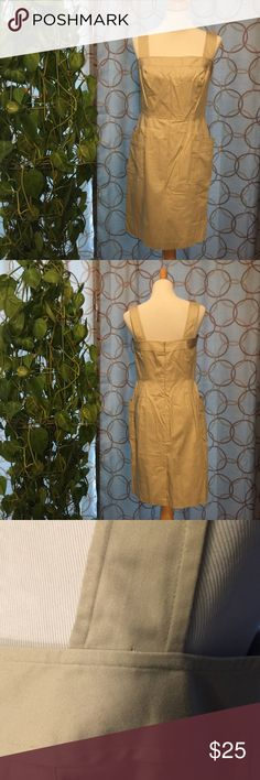 London Times Khaki Dress NWOT Size 10 London Times Khaki Dress. NWOT! Size 10. 2 large front pockets, back zip, with single hook closure. Waist approx. 30 1/2 in. Hips approx. 39 in. Strap length (in front-back is slightly longer) approx. 6 in. Length, strap to hem approx. 38 in. Bust approx. 36 in. Small hole at the bottom of the left front strap, from where the tag was. May diminish with a wash. Shell: 97% cotton, 3% spandex; lining: 100% acetate. 6 inch slit in the back. London Times…