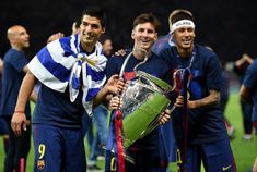 Neymar Photos Photos - (L-R) Luis Suarez, Lionel Messi and Neymar of Barcelona celebrate with the trophy after the UEFA Champions League Final between Juventus and FC Barcelona at Olympiastadion on June 6, 2015 in Berlin, Germany. - Juventus v FC Barcelona  - UEFA Champions League Final
