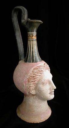 Canosan Oinochoe in the Form of a Woman's Head Origin: Magna Graecia Circa: 350 BC to 250 BC