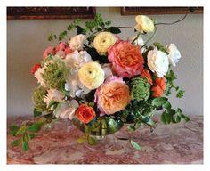 Garden rose, ranunculus, tea rose, hydrangea, queen anne's lace, bupleurum, & jasmine vine  Courtesy of Blush & Vine