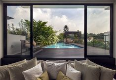 Gorgeous Vertical Garden House by Aamer Architects pool garden terrace
