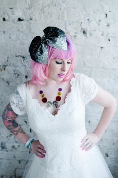 """Pink hair Rock'n'Roll Bride Kat wearing Crown & Glory for Rock'n'Roll Bride """"Gala"""" black sparkly bow headband and vintage lace wedding dress by Fur Coat No Knickers © Alexa Loy Photography (alternative portrait photographer London)"""