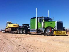 Lime green and black Peterbilt putting in work heavy haul style