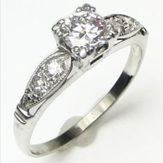 Leaf and Line: A bright white transitional cut diamond is nicely proportioned for the ring, and every element of the design is in beautiful balance. Ca. 1938. Maloys.com