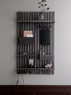 Ferm LIVING Wooden Multi Shelf Get stylishly organised with the multi shelf. Practical wooden pockets, hanging wooden knobs for keys and cloths or tools and different sized shelves. Perfect wall hanging storage in the hallway, kitchen, bathroom Bookcase Wall, Wood Shelves, Wood Wall Shelf, Wand Organizer, Organizing Hacks, Wooden Wall Decor, Wooden Slats, Wood Slat Wall, Crates