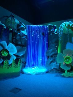 Waterfall with rocks. Rocks made with roofing paper and boxes. Waterfall made with styrofoam insulation sheet, light blue tablecloths from dollar tree, streamers from dollar tree and cello wrap for Easter baskets.