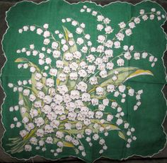 Vintage, cotton, hanky, lily of the valley, which always remind me of my Mom.