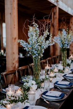 Simple reception centerpieces with a big impact. Tall blue delphinium arrangements with curly willow branches, greenery runner, candles and small accent designs. Floral: Wildflowers LLC Photo: Eden Ingle Photography Source by Blue Wedding Decorations, Wedding Reception Centerpieces, Wedding Reception Flowers, Branch Centerpiece Wedding, Blue Wedding Flowers, Colorful Wedding Centerpieces, Pastel Blue Wedding, Wedding Ceremony, Flowers For Weddings