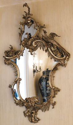 A pair of George II style giltwood girandole-mirrors late 19th century Sotheby's