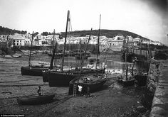 MEN TENDING BOATS (c.1890) | Mousehole, Cornwall: 'The village and fishing port of Mousehole, near Penzance, as it looked in the 1890s, where men can be seen tending to the boats.'     ✫ღ⊰n
