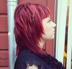 layered medium cherry-red hairstyle  layers too short around her face/neck