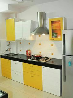 White and yellow go so well in this modern kitchen! // simple ideas for a modern kitchen for interior design, colour for the floors and layout Yellow Kitchen Cabinets, Moduler Kitchen, Kitchen Cupboard Designs, Kitchen Modular, Kitchen Room Design, Modern Kitchen Design, Home Decor Kitchen, Interior Design Kitchen, Yellow Kitchen Designs