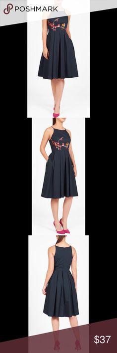 "New Eshakti Navy Bird Fit & Flare Dress S 6 New Eshakti navy bird  embellished fit & flare dress. Size 6 Measured flat: underarm to underarm: 32"" Waist: 29"" Length: 41"" Eshakti size guide for 6 bust: 35"" Slim straps, cut away shoulders, princess seamed bodice. Seamed waist, box pleated skirt, side seam pockets. Bird & cherry blossom branch embroidered tank bodice, back hidden zipper. Cotton, woven poplin, pre-shrunk, smooth finish, light crisp feel, no stretch. Machine wash. New w/cut out…"