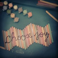 Popsicle sticks + acrylic paint + your favorite phrase sharpied on + a topcoat of modge podge = cute wall art!